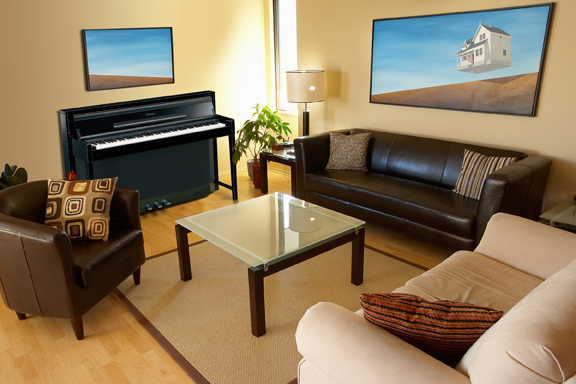 a digital piano sits in a family's living room.