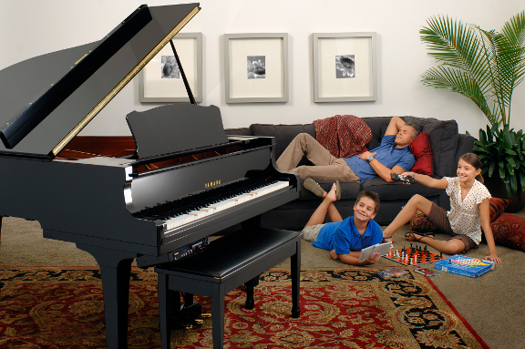 A family enjoys a grand piano in their living room