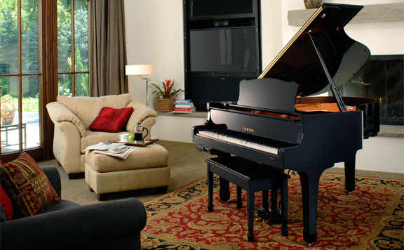 a beautiful piano sits in a family's living room.