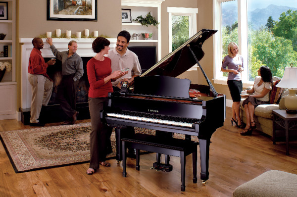 Couples gathered enjoying a Yamaha grand piano